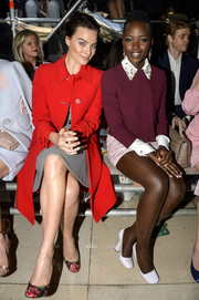 Lupita Nyong'o dressed the part - sitting front row at the Miu Miu runway show in a lovely cropped jacket.