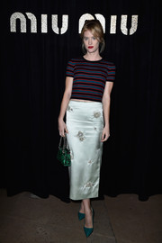 Mackenzie Davis was cute and sporty in a Miu Miu cropped tee, in blue, black, and red stripes, when she attended the brand's fashion show.