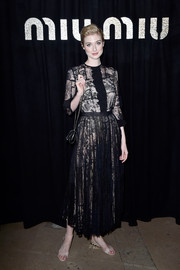 Elizabeth Debicki kept it classic in a lace-overlay LBD when she attended the Miu Miu fashion show.