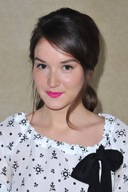 Anais Demoustier swept on a potent pink lipstick for the Miu Miu fall 2012 runway show.