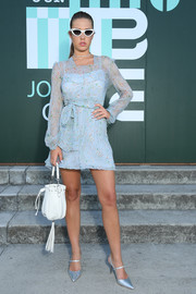 Adele Exarchopoulos injected some shine with a pair of silver slingback pumps.