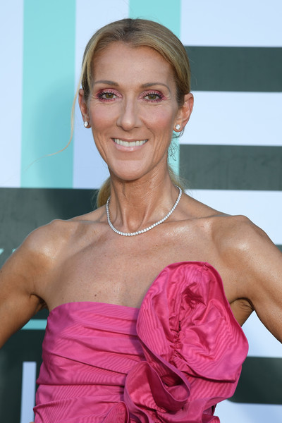 Celine Dion accessorized with a classic diamond tennis necklace and matching earrings.