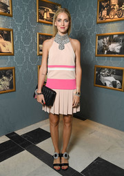 Chiara Ferragni completed her ensemble with a black matelasse clutch, also by Miu Miu.