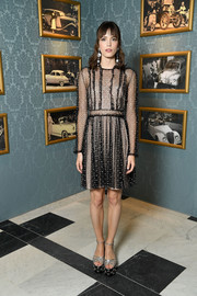 A pair of silver and black Miu Miu sandals with studded platforms finished off Stacy Martin's look.