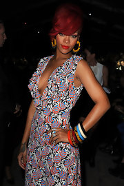 Rihanna paired her printed dress with an arm full of colorful bangles.