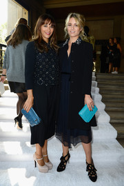 Rashida Jones attended the Miu Miu fashion show wearing a pair of navy culottes and a matching embellished top.