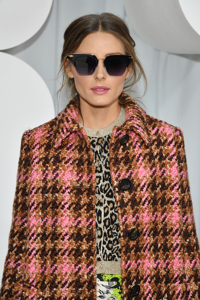 Olivia Palermo attended the Miu Miu Spring 2019 show wearing a pair of modernized cateye sunnies.
