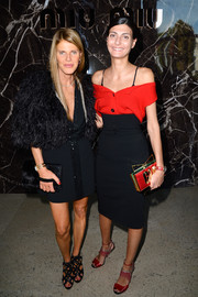 Giovanna Battaglia's high-waisted black pencil skirt and red off-the-shoulder top at the Miu Miu fashion show were a super-chic pairing.