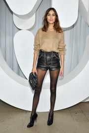Alexa Chung injected a dose of sex appeal with a pair of studded leather hot pants.