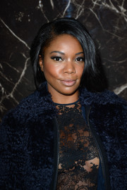 Gabrielle Union looked very dramatic with her loose ponytail at the Miu Miu fashion show.