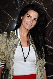 Angie Harmon wore her lush locks in sexy waves when she attended the Miu Miu fashion show.