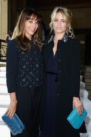 Dianna Agron brightened up her ensemble with a quilted aqua clutch when she attended the Miu Miu fashion show.