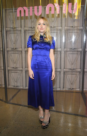 Dakota Fanning styled her dress with a pair of embellished platform sandals, also by Miu Miu.