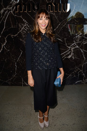 Rashida Jones went for a conservative look with an beaded navy top and a pair of culottes when she attended the Miu Miu fashion show.