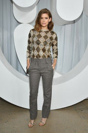 Kate Mara was casual and cool in a diamond-patterned sweater at the Miu Miu Spring 2019 show.