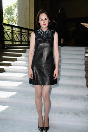 Michelle Dockery was rocker-glam at the Miu Miu fashion show in a black leather dress with an embellished neckline.