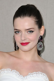 Roxane Mesquida wore a bold fuchsia lipstick to the Mui Mui fashion show in Paris. To try out her statement-making look at home, try a product like NARS lipstick in Funny Face.