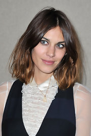 To recreate Alexa Chung's fresh-faced look, either go sans foundation or use one with a sheer finish followed by a light dusting of translucent powder. A hint of gray eye pencil swept across the lids and lightly smudged followed by a coat of mascara completes the look. To keep lips hydrated without adding color, try a product like Rosebud Perfume Co. Rosebud salve.