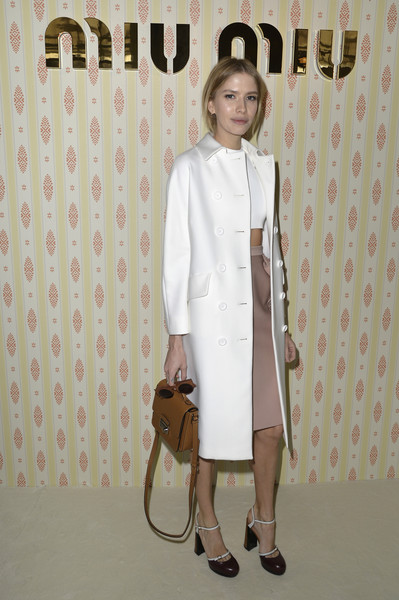 Elena Perminova styled her outfit with retro-chic brown and white ankle-strap pumps.