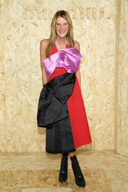 Anna dello Russo couldn't be missed in her bow-adorned, color-block strapless dress at the Miu Miu Spring 2020 show.