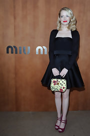 Emma was a total Debby in this strapless LBD at the Miu Miu fashion show in Paris.