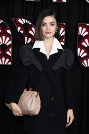 Lucy Hale arrived for the Miu Miu Fall 2020 show carrying an oversized blush leather clutch.
