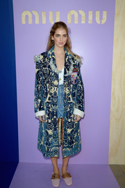 Chiara Ferragni attended the Miu Miu fashion show looking opulent in a pearl-embellished brocade coat from the label.