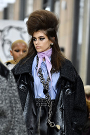 Kaia Gerber accessorized with a super-edgy silver chain at the Miu Miu runway show.
