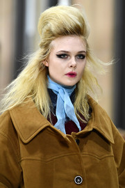 Elle Fanning hit the catwalk wearing a pastel-blue neckerchief and a camel coat.