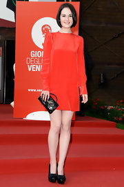 Michelle proved that you can wear red on a red carpet when she donned this long-sleeve crepe-de-chine mini dress.