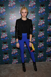 Peyton List teamed her jacket with a pair of sporty blue leggings.