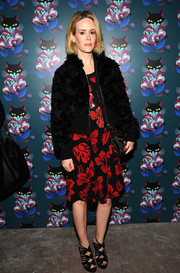 Sarah Paulson layered a funky fur bomber jacket over a print dress for the 'Spark & Light' screening.