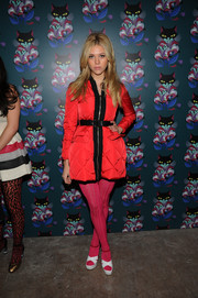 Nicola Peltz wore patterned fuchsia tights for an extra pop of color.