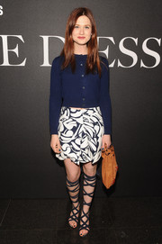 Bonnie Wright paired her cardigan with a retro-chic printed mini skirt by Miu Miu.