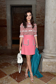 A pink mini skirt with bedazzled pockets, also by Miu Miu, finished off Hailee Steinfeld's outfit in retro-sweet style.