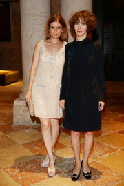 Kate Mara paired her dress with sky-high nude platform sandals, also by Miu Miu.