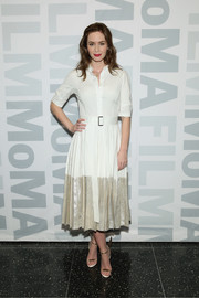 Emily Blunt styled her dress with whimsical angel-wing sandals by Sophia Webster.