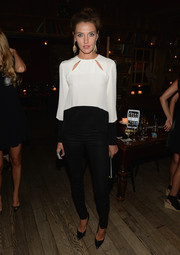 Alina Baikova looked darling in this black and white ensemble, accented with over-sized dangling earrings.