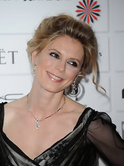 Emilia Fox wore her hair in a fun, flirty updo at the 2011 Moet British Independent Film Awards.