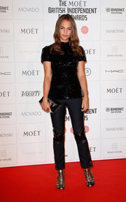 Alicia Vikander was casual-chic on the Moet British Independent Film Awards red carpet in a short-sleeve black sequined top.
