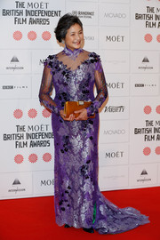 Cheng Pei-Pei's rust-colored satin clutch provided a striking color contrast to her purple dress.