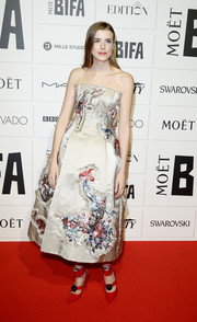 Agyness Deyn donned a Giles strapless dress featuring Oriental-inspired embroidery for her Moet British Independent Film Awards look.