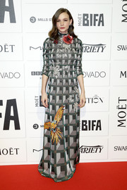 Carey Mulligan cut a vibrant figure at the Moet British Independent Film Awards in a Gucci geometric-print lurex gown with colorful bird and flower accents.