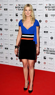 Rosamund wore a unique cocktail dress with blue a chiffon bodice and a striped waist design.
