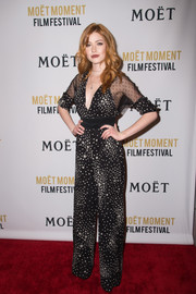 Katherine McNamara looked simply fab in a black-and-white star-print jumpsuit at the Moet Moment Film Festival.