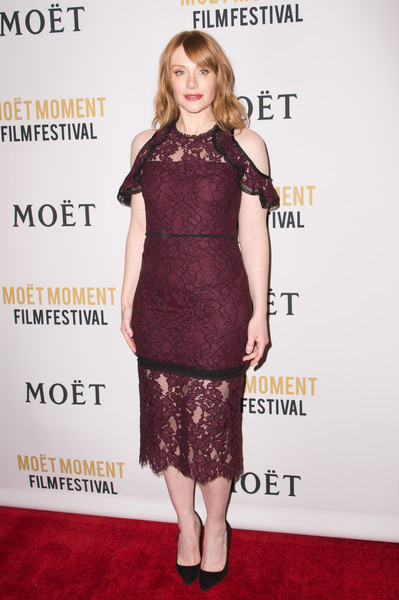 Bryce Dallas Howard looked very ladylike in a plum-colored cold-shoulder lace dress by Alexis at the Moet Moment Film Festival.