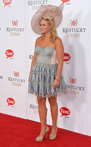 Miranda Lambert chose a flower-embellished beige straw hat for the Kentucky Derby Moet & Chandon toast.