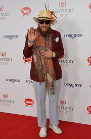 Nicholas David sported a busy ensemble at the Kentucky Derby Moet & Chandon toast, topped off with a fringed paisley scarf.