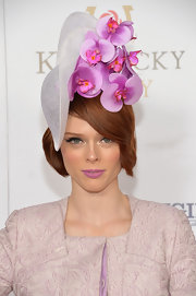Coco Rocha looked oh-so-pretty in her orchid hat at the Kentucky Derby Moet & Chandon toast.