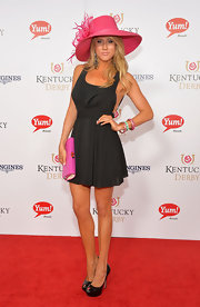 Angela Zatopek wore a super sultry little black dress to the Kentucky Derby Moet & Chandon toast.